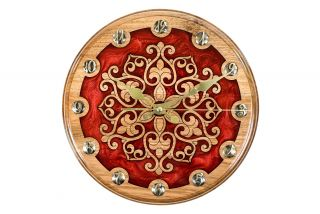 Clock with ornamental motif
